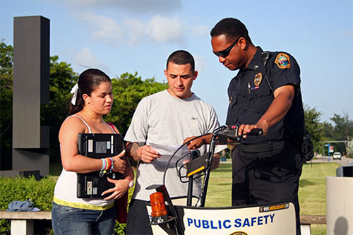 Public Safety Police Officer Helping Two Students