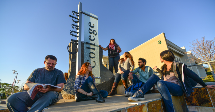 canada students in front of sign on campus